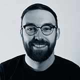 A black and white headshot image of the Eccomerce Account Manager for Castle, Jack Doran.