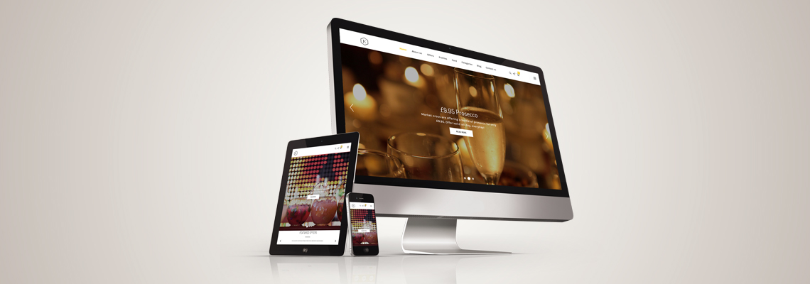 An Apple computer, an iPad and an iPhone all showing the Essential website homepage.