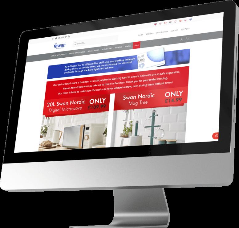A Mac displaying Swan's website