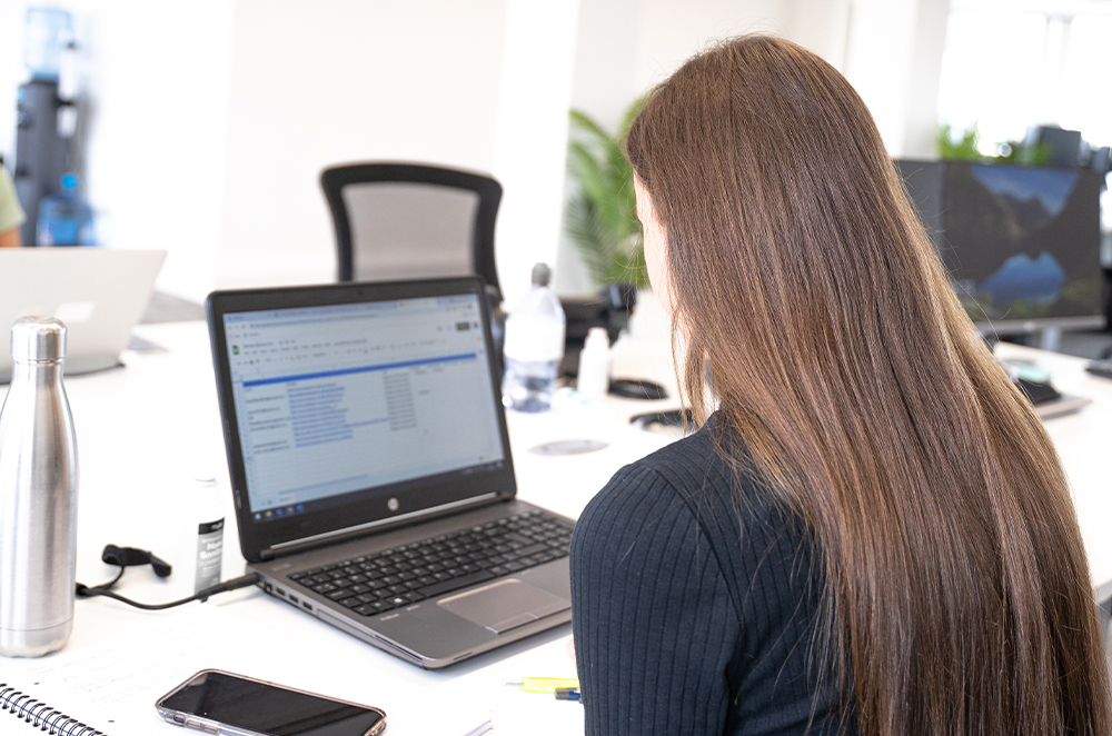 A behind the shoulder image of one of the Affiliate team members from Castle working on an excel document.