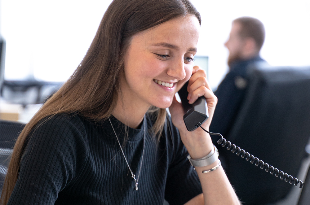 The Affiliate Assistant Olivia Wilson from Castle having a phone conversation with a client.