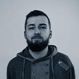 A black and white headshot image of the Senior Web Developer for Castle, Dan Shaw.