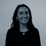 A black and white headshot image of the Affiliate Manager for Castle, Danielle Hulligan.
