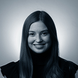 A black and white headshot image of the PR Manager for Castle, Ella Whitby.