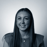 A black and white headshot image of the Affiliate Assistant for Castle, Emma Cottham.