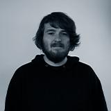 A black and white headshot image of the Web Developer for Castle, Finn Kennedy.