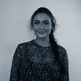 A black and white headshot image of the Affiliate Assistant for Castle, Isobel Bridge.