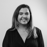 A black and white image of Castle's Affiliate Manager, Lauren Yates.