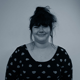 A black and white headshot image of the SEO & Web Admin Assistant, Lauren Henderson.