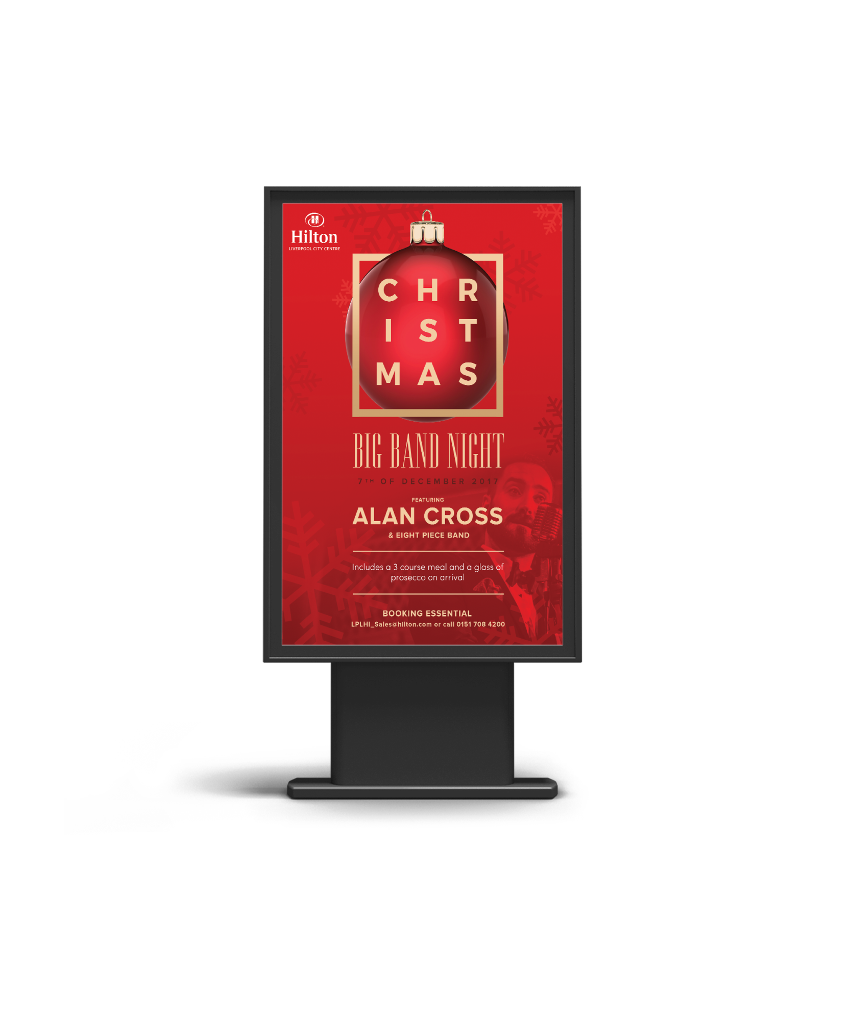 A red billboard poster promoting an event at the Hilton for a Christmas Big Band Night featuring Alan Cross.