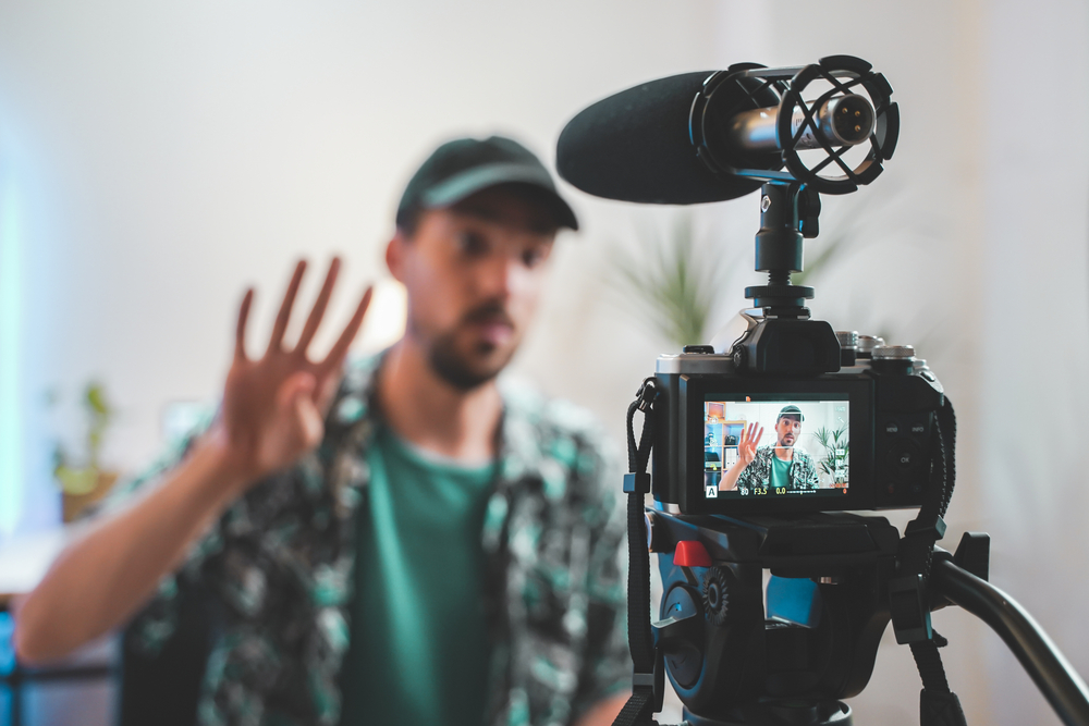 A behind the scenes shot of an influencer recording a video for an affiliate marketing team.