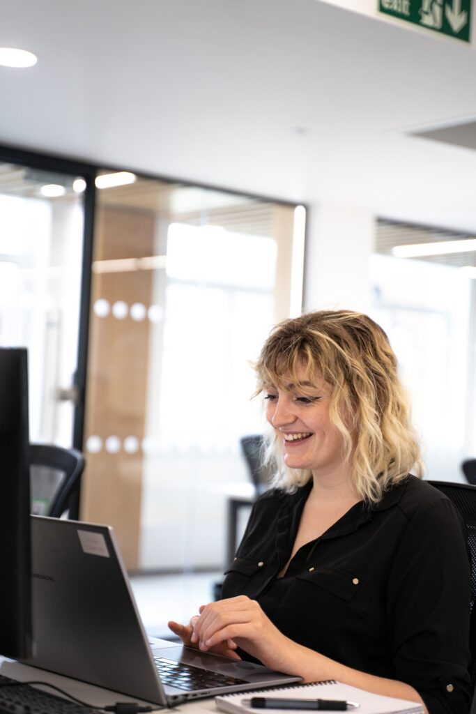 Castle's Head of SEO, Rachel Walton working on her laptop for an SEO client.
