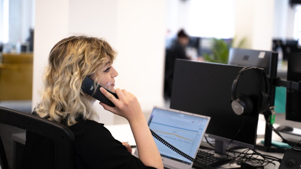 Castle's head of SEO, Rachel Walton on the phone to a client giving them a report on what is bounce rate in SEO.