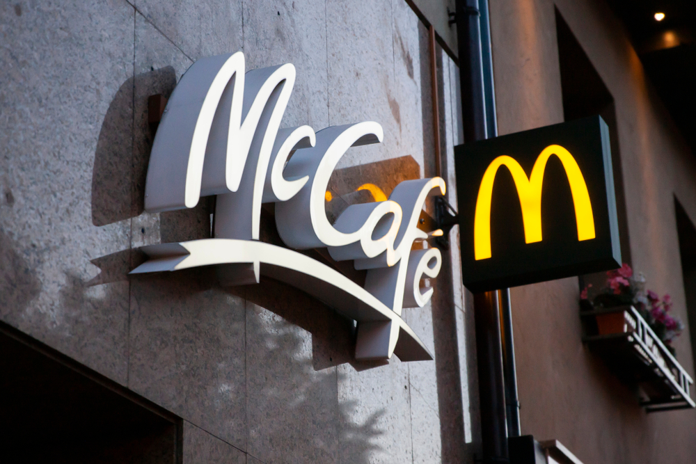 The outside of a McDonald's restaurant showing the McCafe sign to demonstrate what is product branding and how effective it can be,