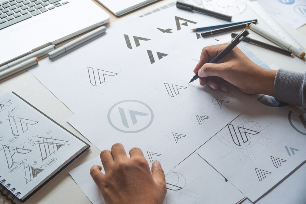 A graphic designer working on a brand to figure out what is product branding.